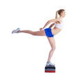 Young fitness woman on stepper