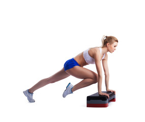 Slim young woman with stepper