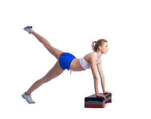 Young fitness woman with stepper