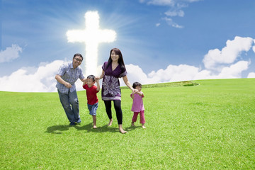Catholic family at the Cross