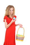 child holding easter egg and basket