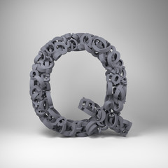 Letter Q made out of scrambled small letters in studio setting