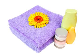 lilac towel, nail polish, gerbera