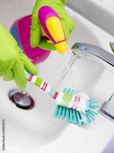 Spring cleaning ,Cleaning bathroom sink with spray detergent
