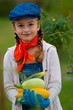 Vegetable garden - lovely girl with zucchini