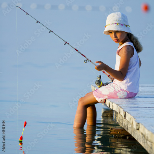 Fishing - girl  fishing on the pier