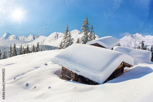 Snow covered hut winter landscape