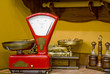 Leinwandbild Motiv Red kitchen scales in the old style