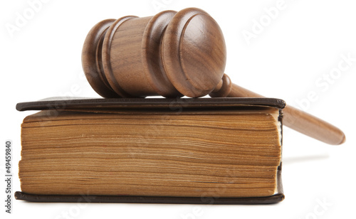 Wooden gavel and old book isolated