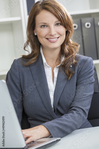 Woman or Businesswoman Using Laptop Computer in Office
