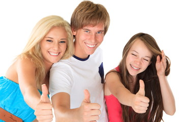 Sisters and brother with thumbs up sign