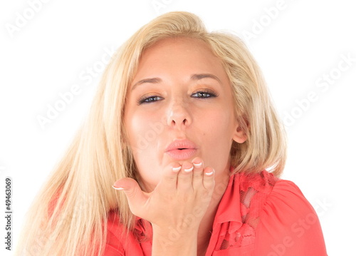 Blond woman blowing kiss