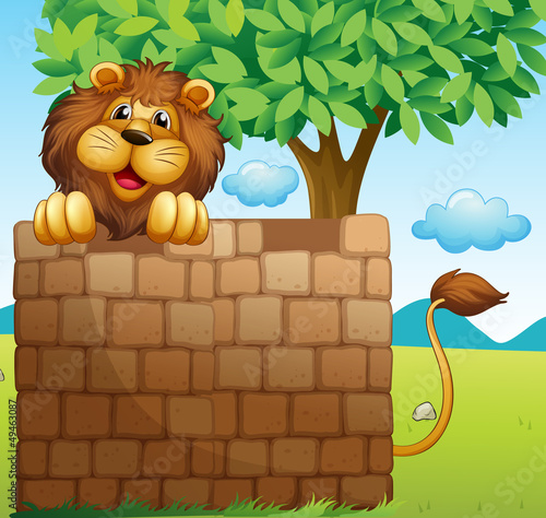 A lion inside a pile of bricks