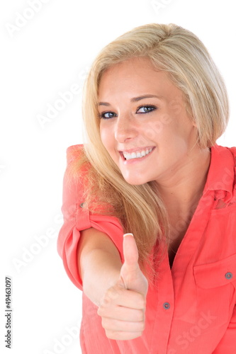 Young woman gives thumbs up sign