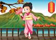 A girl in a kimono attire at the bridge