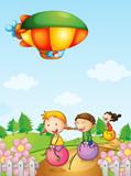 Three kids playing below an airship