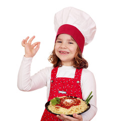 happy little girl cook with spaghetti
