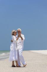 Happy Senior Couple Dancing on Tropical Beach