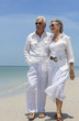 Happy Senior Couple Walking by Sea on Tropical Beach