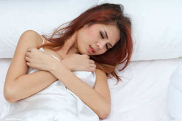 woman on bed with pain at her breast or heart attack