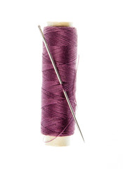 reel with thread and needle