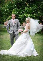 Wedding couple on a green grass