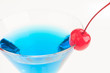 Blue Citrus Martini close up and garnish with maraschino cherry