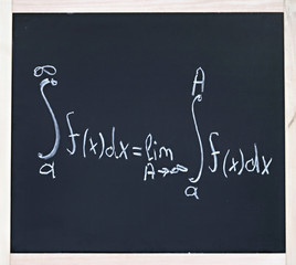 Advanced mathematics formula written in chalk on blackboard