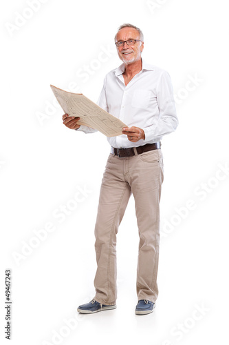 Casual senior man with newspaper, looking to camera