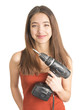 Attractive young woman holding cordless screwdriver