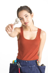 Attractive young woman holding monkey wrench