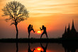 Silhouette of a thai's boxing at sunset - 49468068