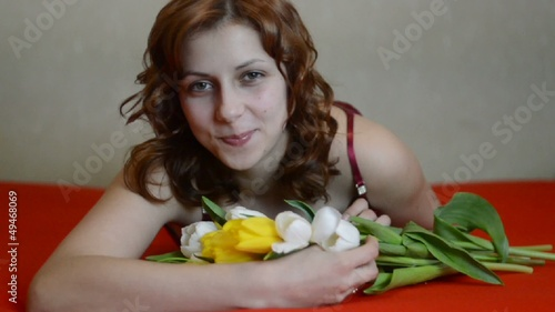 beautiful girl with a bouquet of tulips