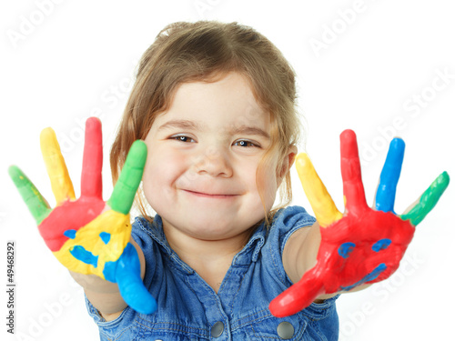 Cute little girl is proud of her coloured hands