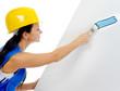 Beautiful young woman doing repairs
