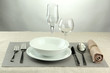 Table setting, on grey background