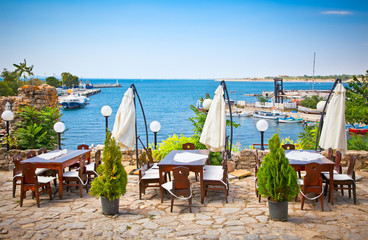 Table with a beautiful sea view on harbor in Nessebar , Bulgaria