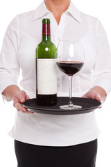 Waitress serving red wine with glass and bottle on a tray.