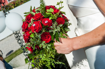 wedding bouquet with bride arm