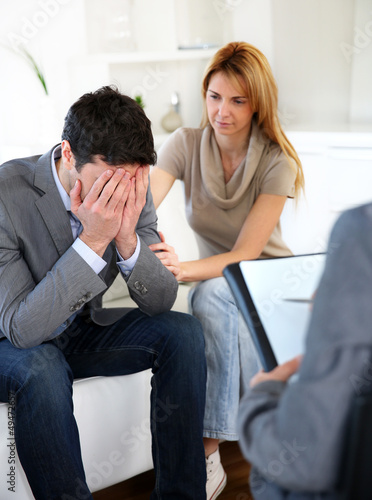 Couple visiting therapist for assistance