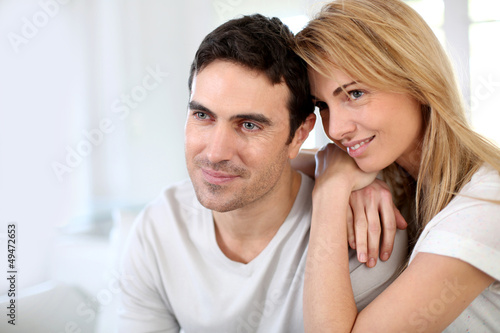 Couple embracing each other on sofa