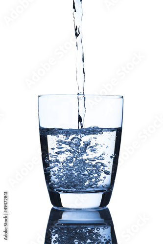Water pour into glass of water