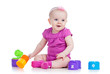 Funny baby girl playing with cup toys, isolated over white