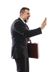 Agressive businessman shouting phone.