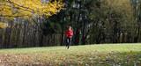 women jogging in the woods