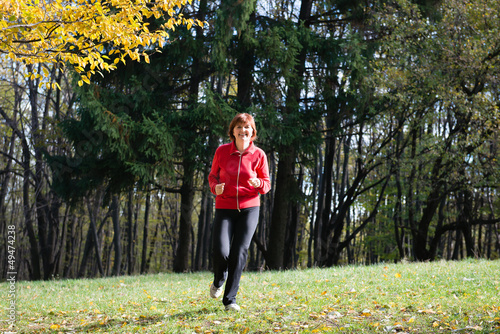 women jogging in the woods