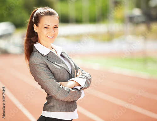 Business woman at athletic stadium