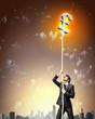 Image of businessman climbing rope