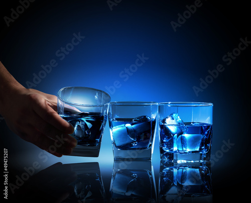 Three glasses of blue liquid