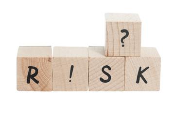 Word Risk Written With Wooden Blocks.